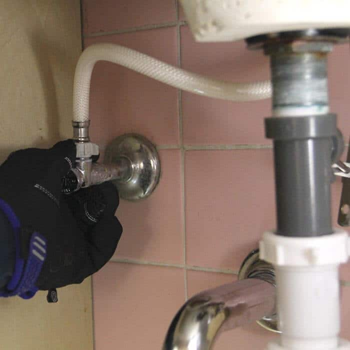 Remove old bathroom sink faucet 1
